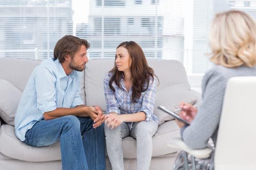 couple sitting on couch at couples therapy